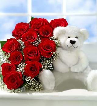 Teddy bear and bouquet of roses